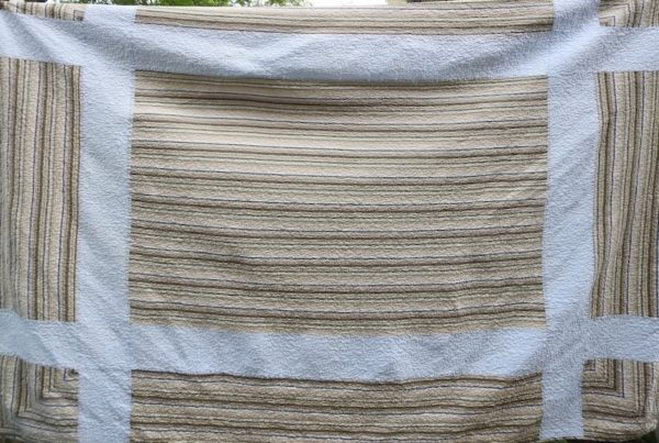 quilt with tan and white stripes