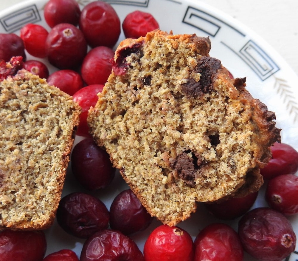 sliced muffin on a plate of cranberries